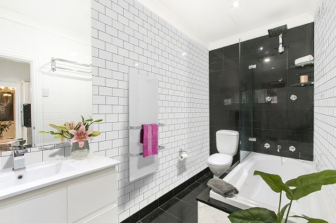 Calentador de toallas de vidrio para baños modernos